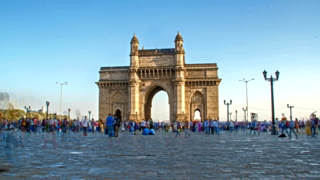 Time lapse shot of people moving around Gateway of India on a bright sunny day, Mumbai, India video
