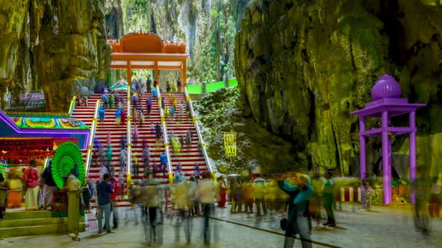 time lapse shot of thaipusam ceremonies at batu caves in malaysia - верующий стоковые видео и кадры b-roll