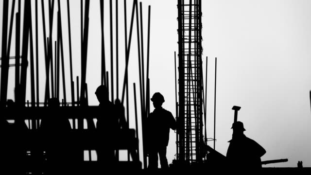 time lapse -silhouette construction site with import workers