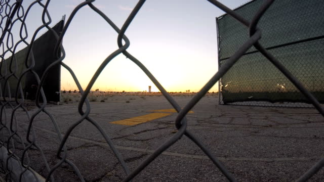 Time lapse slider of airport behind chainlink fence video
