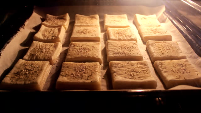 time lapse small muffins puff pastry in the kitchen oven video