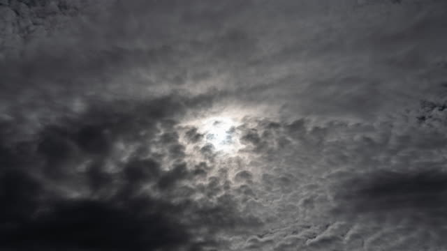 time lapse storm clouds are coming and covering the sun - d'atmosfera video stock e b–roll
