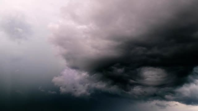 time lapse storm clouds moving over city - pioggia torrenziale video stock e b–roll