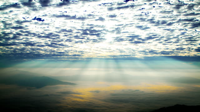 Time Lapse: Sunlight over foggy mountains video