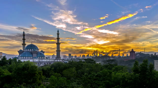 Time lapse. Sunrise at Federal Mosque, Kuala Lumpur with silhouette Kuala Lumpur city skyline. video