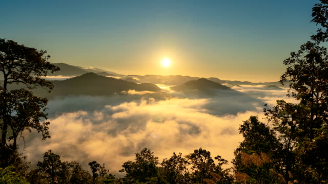 Time lapse Sunrise over mountain with mist and fog cloud