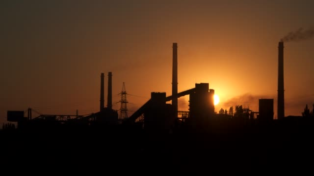 time lapse. sunrise over the metallurgical plant - metallurgia video stock e b–roll