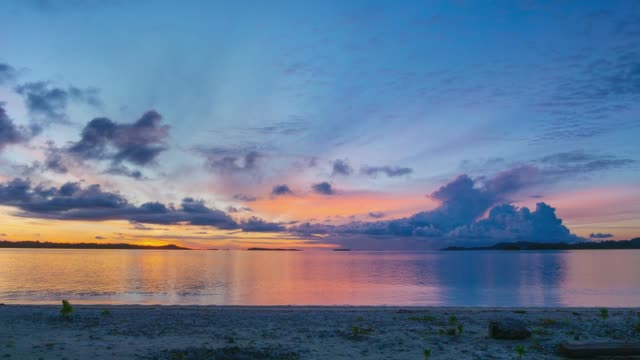 Time lapse sunrise over tropical beach and sea. Colorful dramatic sky at dusk. Romantic passion concept. Banyak Islands, Sumatra, Indonesia.