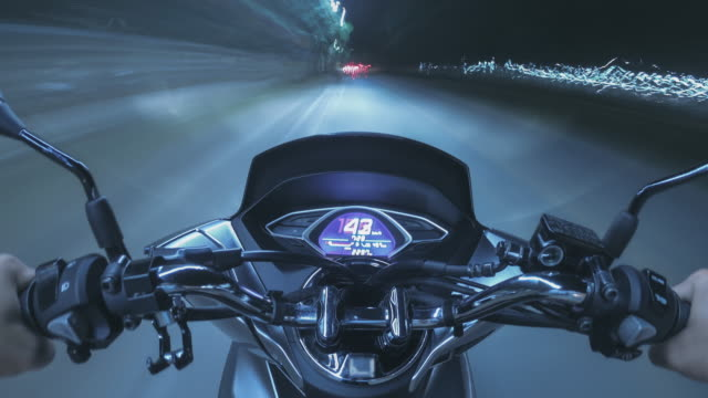 Time lapse The biker is riding a motorcycle travel on the road trip at night time Time lapse The biker is riding a motorcycle travel on the road trip at night time motorcycle stock videos & royalty-free footage