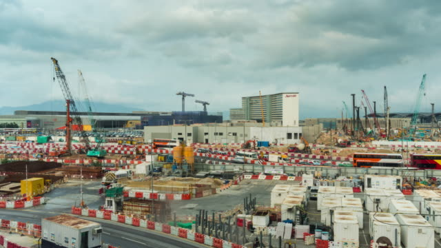 Time Lapse: The construction site at Hong Kong International Airport with cloud sky moving background - vídeo