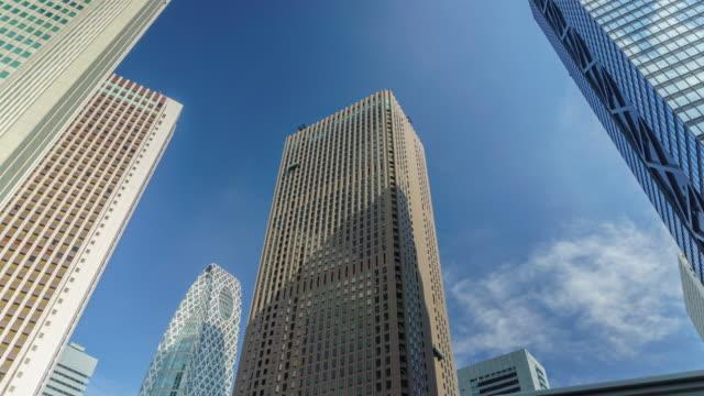 4k time lapse tilt down cityscape office at nishi-shinjuku in tokyo , japan - tilt down stock videos & royalty-free footage
