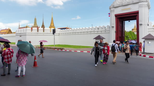 4K Time lapse: Tourist crowd in front of Wat Phra Kaew Temple, Bangkok, Thailand.