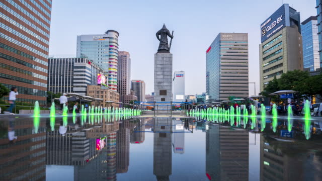 Time lapse Tourists visiting Colour floor water fountain and Statue of Admiral Yi Sun-Shin at Gwanghwamun plaza in Seoul City,South Korea Time lapse Tourists visiting Colour floor water fountain and Statue of Admiral Yi Sun-Shin at Gwanghwamun plaza in Seoul City,South Korea gwanghwamun gate stock videos & royalty-free footage