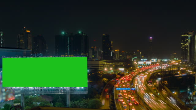 Time Lapse, Traffic and Aerial view night Cityscape with Traffic Turnpike Highway at downtown Bangkok.