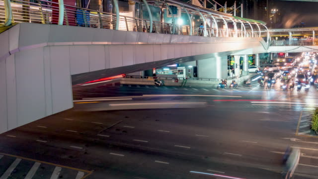 Time Lapse, Traffic and Aerial view night Cityscape with Traffic Turnpike Highway at downtown Bangkok. 4K, Time Lapse, Traffic and Aerial view night Cityscape with Traffic Turnpike Highway at downtown Bangkok, Thailand. sunset to night time lapse stock videos & royalty-free footage