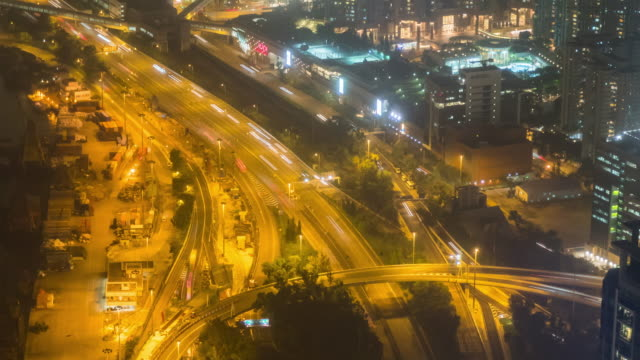 4K Time Lapse: Traffic and construction of Hong Kong downtown at Tsim Sha Tsui - vídeo