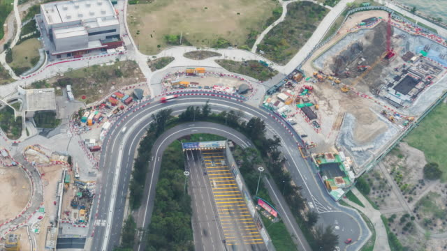 4K Time Lapse: Traffic and construction of Hong Kong downtown at Tsim Sha Tsui district - vídeo