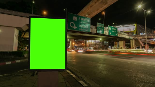 Time lapse, Traffic long exposure on road with Billboard green screen use for advertising street signs in city. Time lapse, Traffic long exposure on road with Billboard green screen use for advertising street signs in city. bus stop stock videos & royalty-free footage