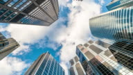 istock 4K Time lapse Uprisen angle of Downtown Chicago skyscraper with reflection of clouds among high buildings, Illinois, United States, Business and Perspective concept 1168963779