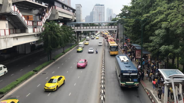 Time lapse various pubic transportation in chatuchak mochit Bangkok,Thailand Public transportation at mochit bts station and chatuchak famous market bus stop with people walking everywhere during various car on road bus stop stock videos & royalty-free footage