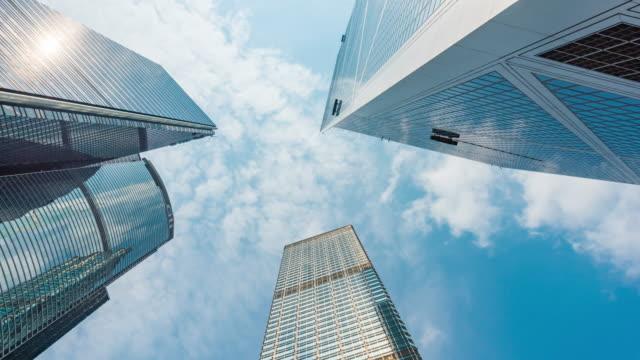 4k time lapse : vertical view of high rise skyscraper buildings in hong kong city. modern city business district background - центральный район стоковые видео и кадры b-roll
