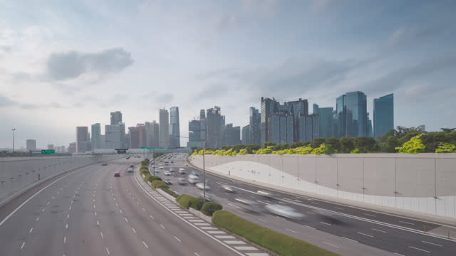 Time lapse video 4K, Traffic view with background Singapore landmark financial business district with skyscraper, traffic into city February 2, 2020 in Singapore. Beautiful moment of Traffic in Singapore singapore architecture stock videos & royalty-free footage