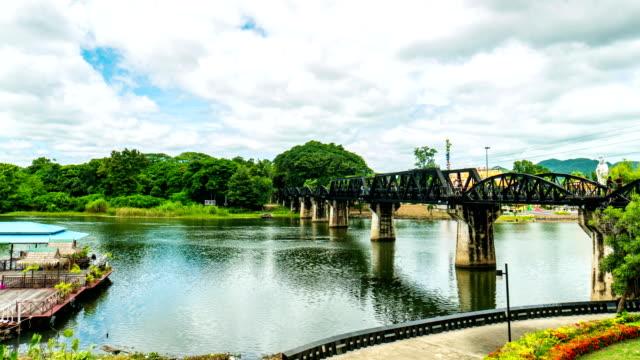 time lapse video : bridge over the river kwai, kanchanaburi province, thailand - rivoluzione industriale video stock e b–roll