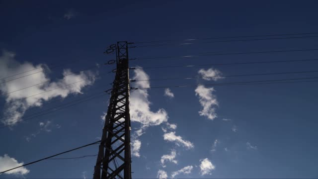 time lapse Clouds over the Transmission Tower high voltage sign stock videos & royalty-free footage