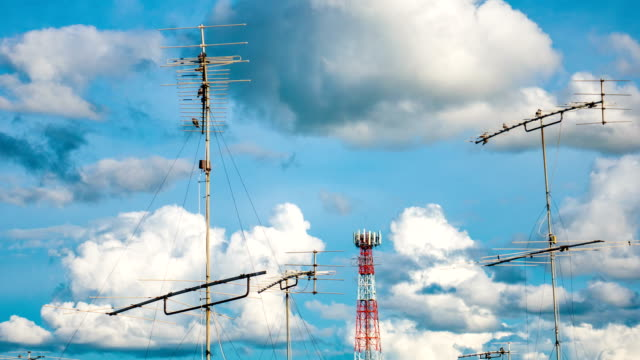 Time lapse video of Aerial television antenna with cloud moving and blue sky, zoom shot video