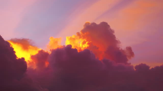 Time lapse video of awesome changing cloudscape at sunset in 4K