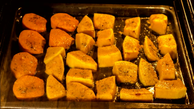 time lapse video of cooking pumpkin in oven - zucca video stock e b–roll