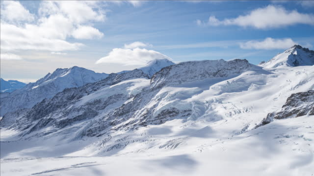 Time lapse video of Jungfrau with blue nice sky in Switzerland Time lapse video of Jungfrau with blue nice sky in Switzerland. european alps stock videos & royalty-free footage