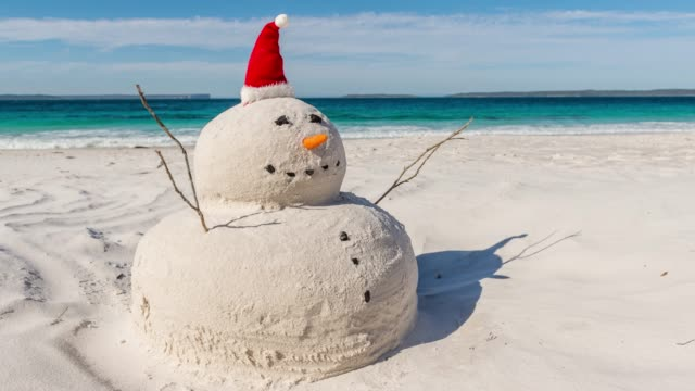 Time lapse video of the Australian Christmas Sandman 4K Time lapse video with zoom effect of Australian Christmas Sandman on a beautiful white sandy beach christmas fun stock videos & royalty-free footage