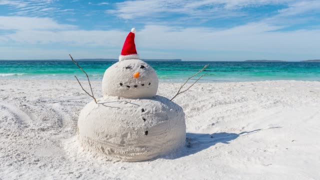Time lapse video of the Australian Christmas Sandman Time lapse video with sliding effect of Australian Christmas Sandman on a beautiful white sandy beach snowman stock videos & royalty-free footage