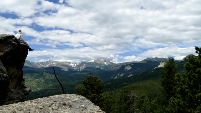 Time lapse video summer hiker clouds build Mount Evans Wilderness Rocky Mountains Colorado video