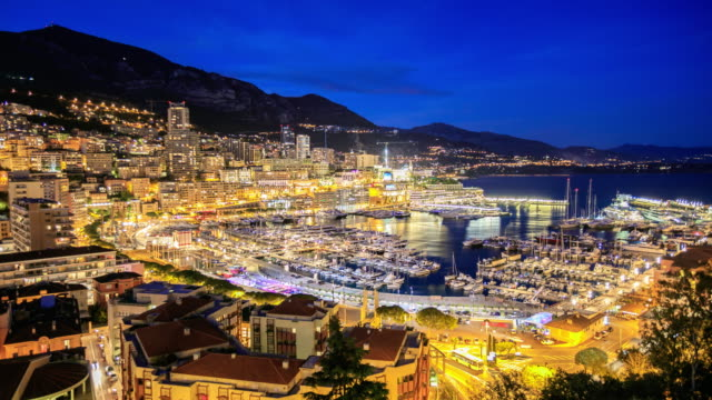 4K Time Lapse : View in harbor of Monaco View of luxury yachts and apartments in harbor of Monaco, Cote d'Azur, 4K 3840x2160 Format monte carlo stock videos & royalty-free footage
