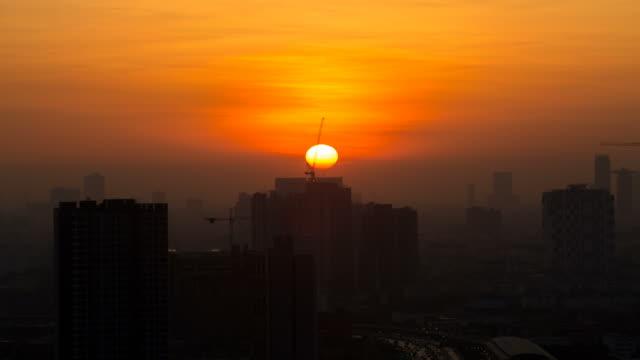 Time lapse view of Bangkok skyline at sunrise. video