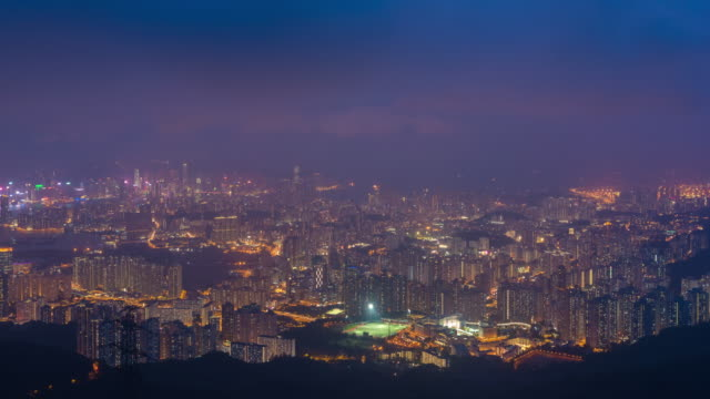 4K Time Lapse : view of high rise skyscraper buildings in Hong Kong city. modern city business district background at night video
