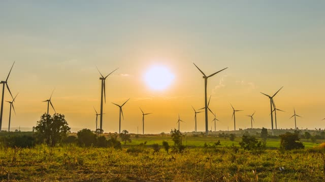 4K Time lapse View of wind Turbines with Sunset video