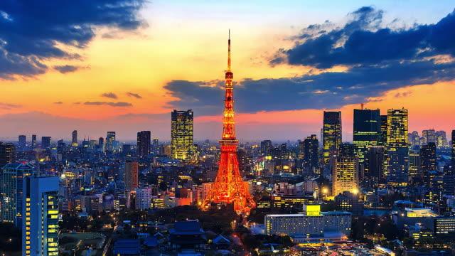 日本の東京タワーと東京都市で 4 k. 時間経過ビュー サンセット - 東京タワー点の映像素材/bロール