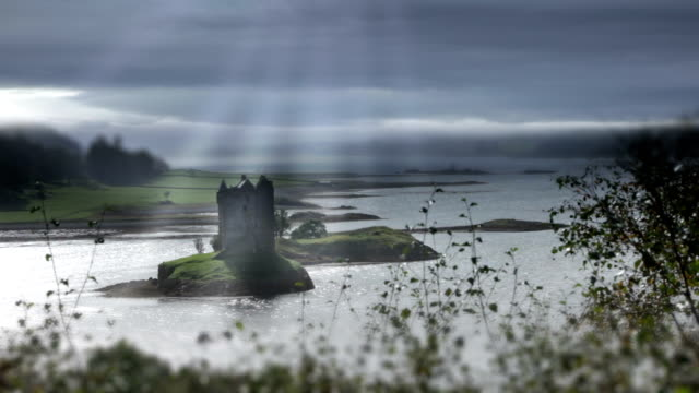 Time lapse weather over Scottish castle