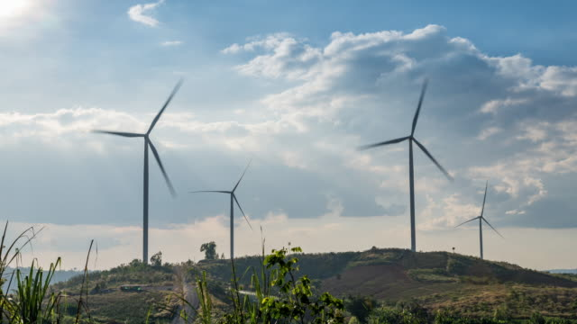 Time lapse Wind turbines on hills landscape video