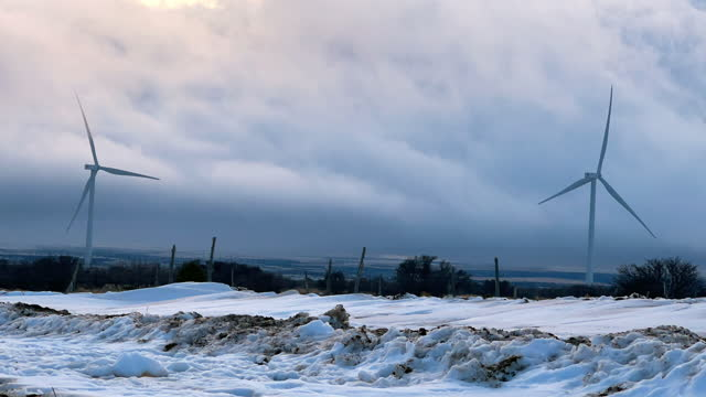 Time Lapse Wind Turbines, Wind Farm Near Monticello, Utah On A Foggy, Snowy, Windy Winter Day