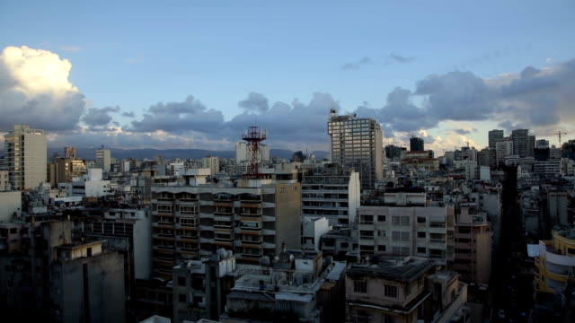 Time lapse with clouds, sunset - Beirut, Lebanon Time lapse of capital of Lebanon, Beirut. Thick cumulus clouds in the sky, Sun is setting down with bustling city street in the back. beirut stock videos & royalty-free footage