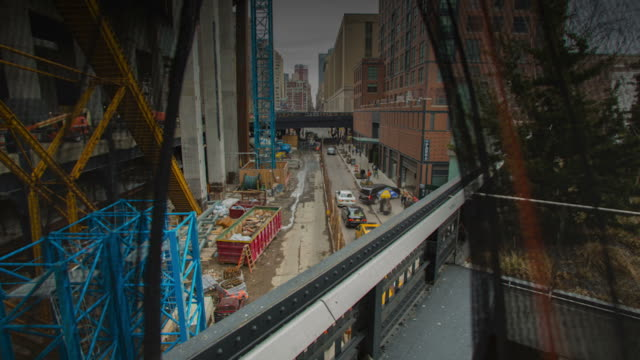 Time lapse workers working on a construction site video