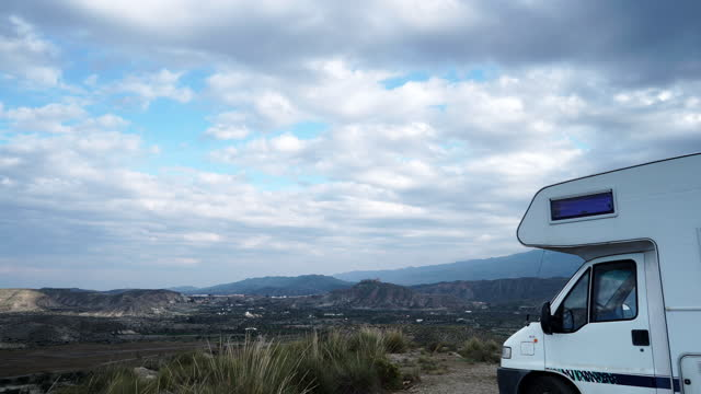 Time lapse.Clouds moving over caravan on Tabernas desert, Spain video