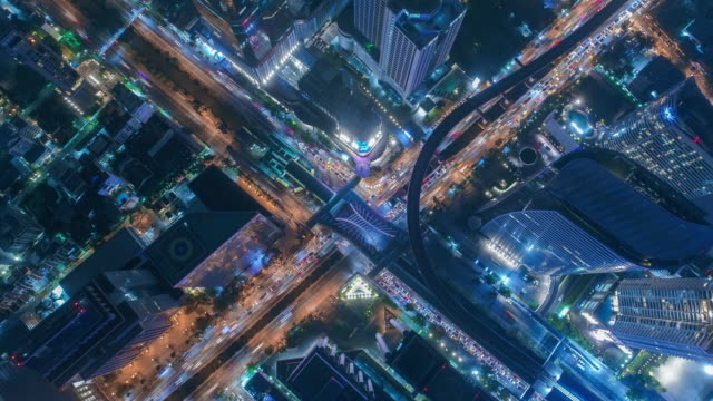 Time lapse,Hyper lapse ,Of traffic on city streets at night. Aerial view and top view of traffic on freeway, 4K. Time lapse,Hyper lapse ,Of traffic on city streets at night. Aerial view and top view of traffic on freeway, 4K. traffic time lapse stock videos & royalty-free footage