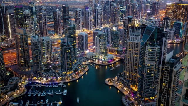 time laspe of dubai marina at dusk - dubai architecture stock videos & royalty-free footage