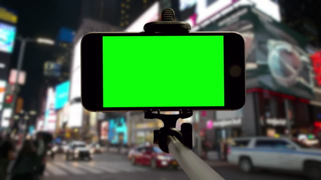 Time Square people crowd smartphone mobile green chromakey New York video