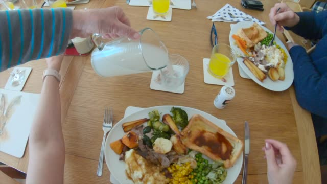 Time to Eat It's time to eat their families Sunday roast! roast dinner stock videos & royalty-free footage